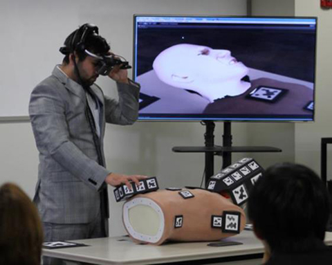 A UCF student from the winning team demonstrates the MREAL System to simulate the conditions of a medical emergency for training first responders (image credit: Canon).